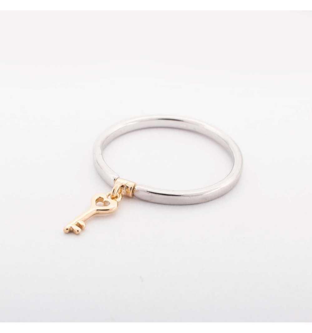 Srebrny pierścionek z pozłacanym kluczem