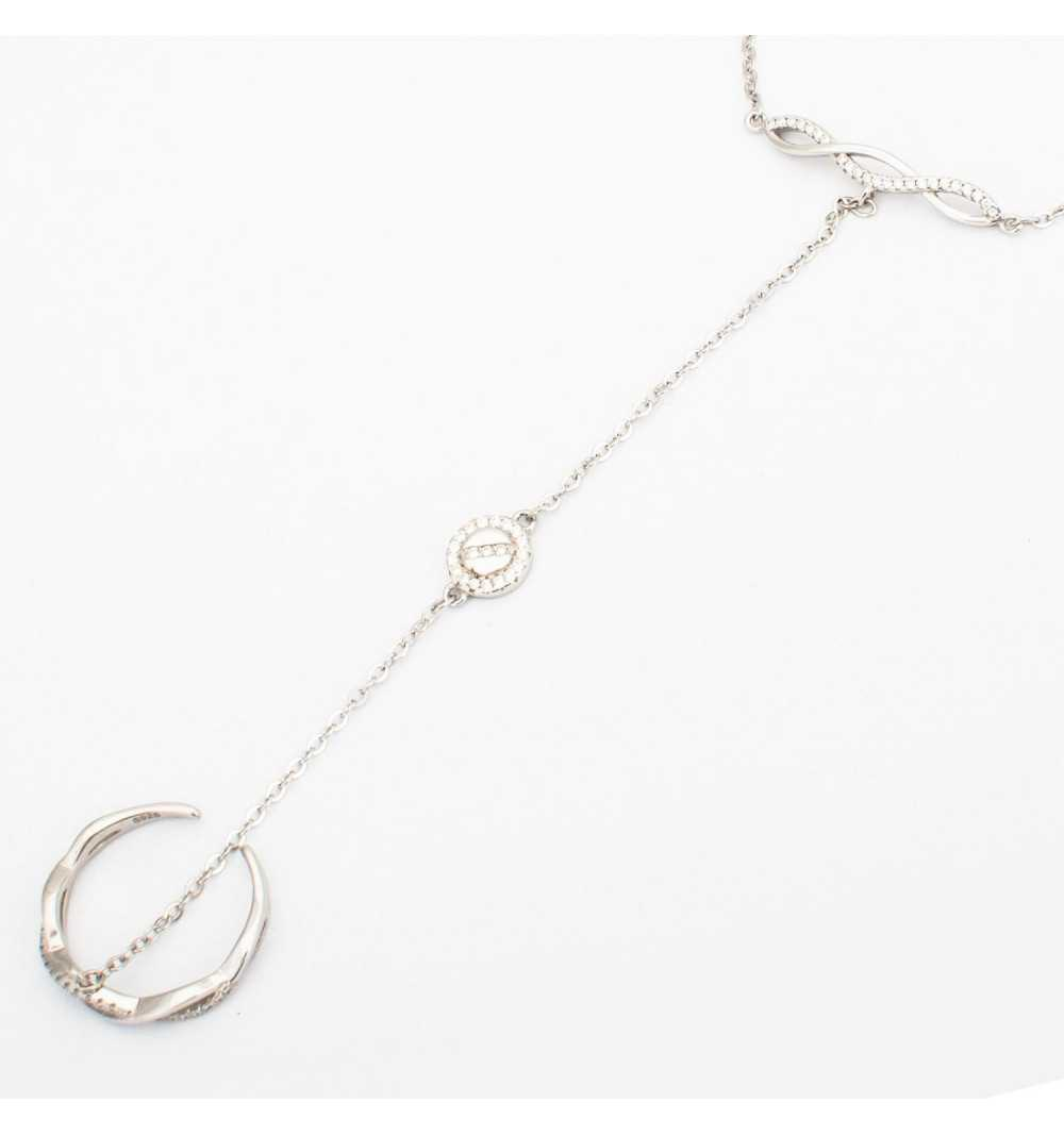 Srebrna bransoletka połączona z pierścionkiem delikatnym łańcuszkiem z kółeczkiem