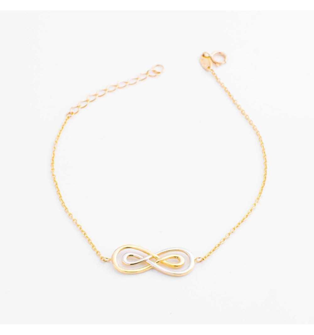 Złota bransoletka z nieskończonościami z białego i żółtego złota