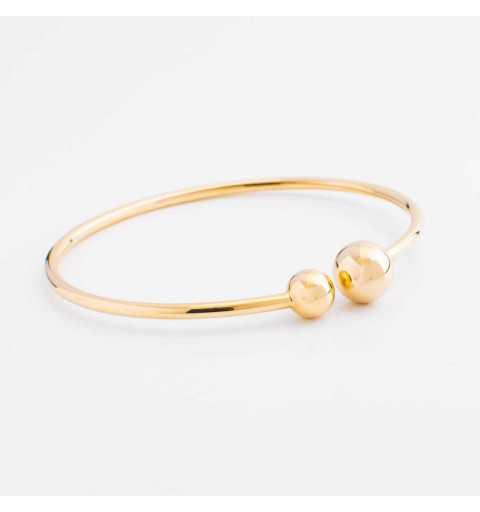 Sztywna złota bransoletka zakończona eleganckimi kulkami