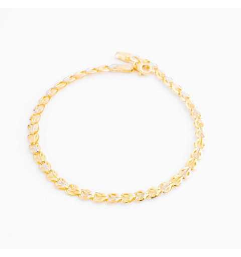 Złota bransoleta z fasetowanymi wstawkami z białego i żółtego złota
