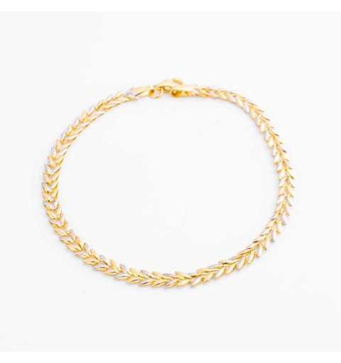 Złota bransoleta z eleganckim wzorem przypominającym listki z białego i żółtego złota