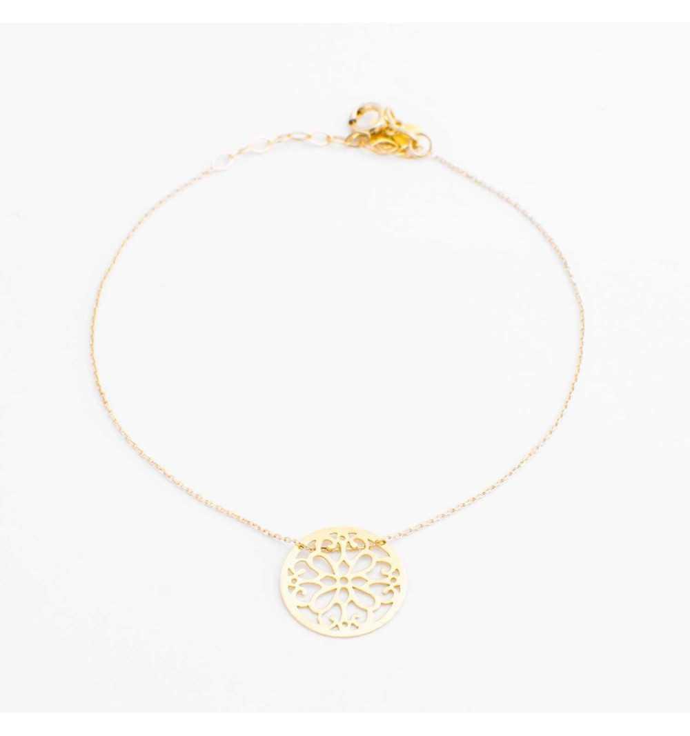 Złota bransoletka z ornamentowym kołem