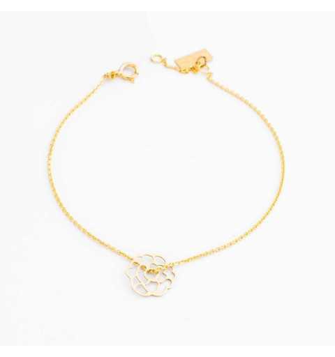 Złota bransoletka celebrytka z ażurowym kwiatem