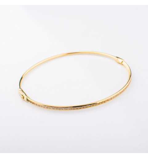 Sztywna złota bransoletka wysadzana cyrkoniami