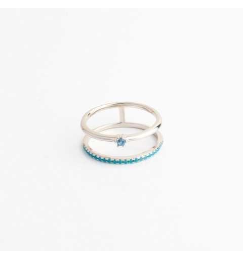Srebrny pierścionek tunel z rzędem niebieskich cyrkonii