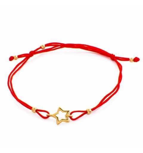 Złota bransoletka z gwiazdką na czerwonym sznurku