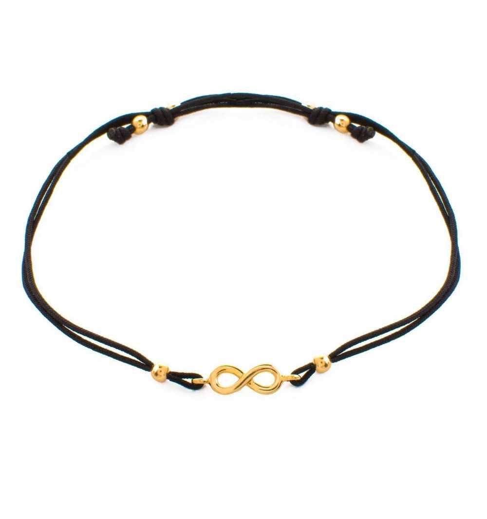 Złota bransoletka z nieskończonością na czarnym sznurku