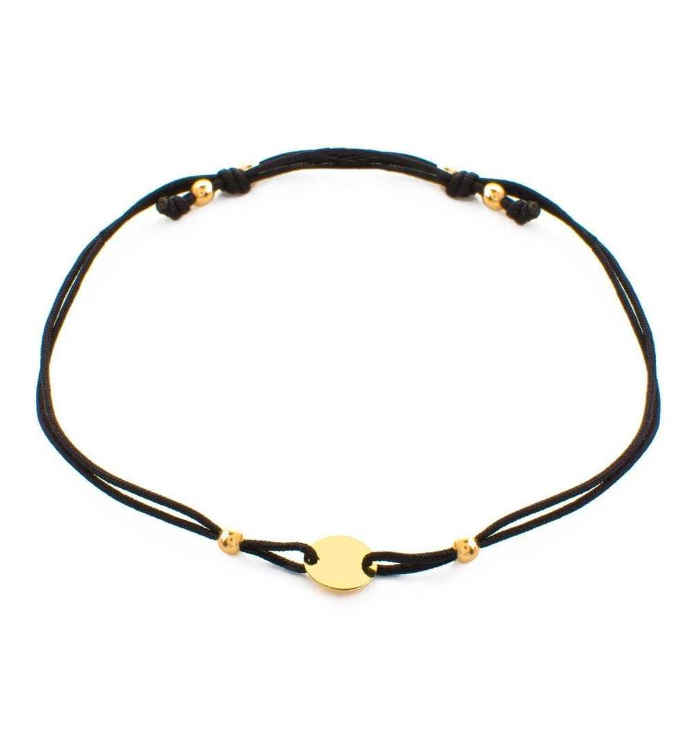 Złota bransoletka z kółkiem na czarnym sznurku