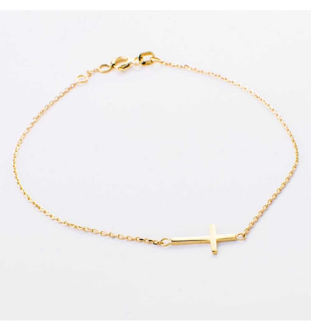 Złota bransoletka z przeciąganym krzyżykiem
