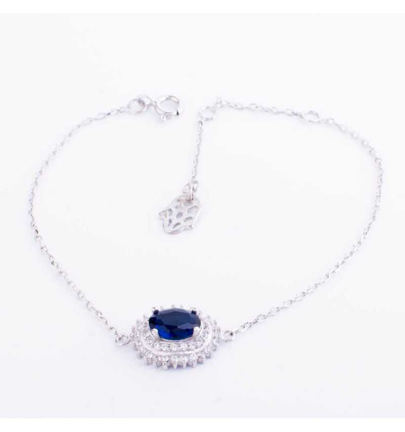Łańcuszkowa srebrna bransoletka z niebieskim kamieniem