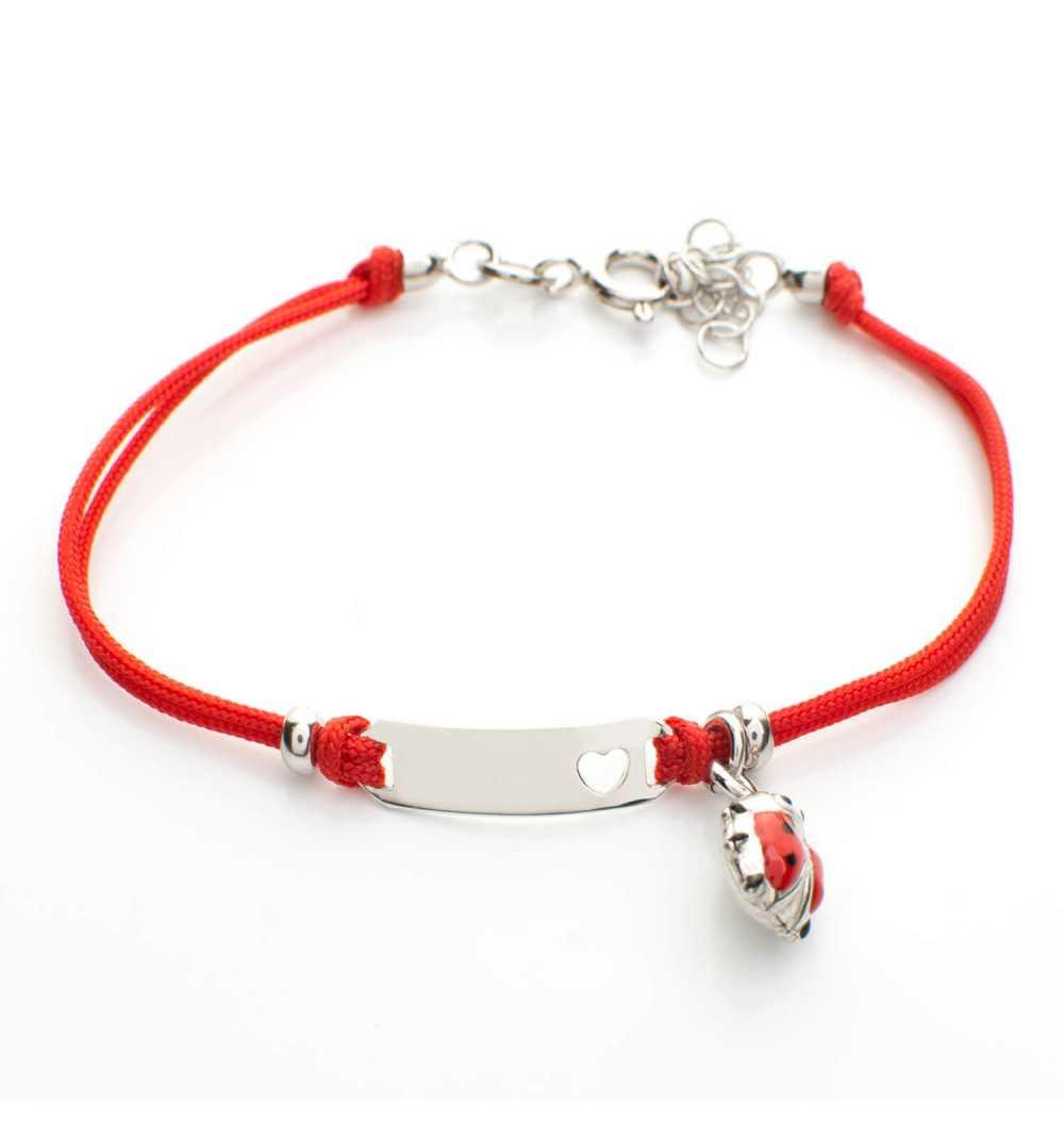Srebrna dziecięca bransoletka na czerwonym sznurku z blaszką i biedronką