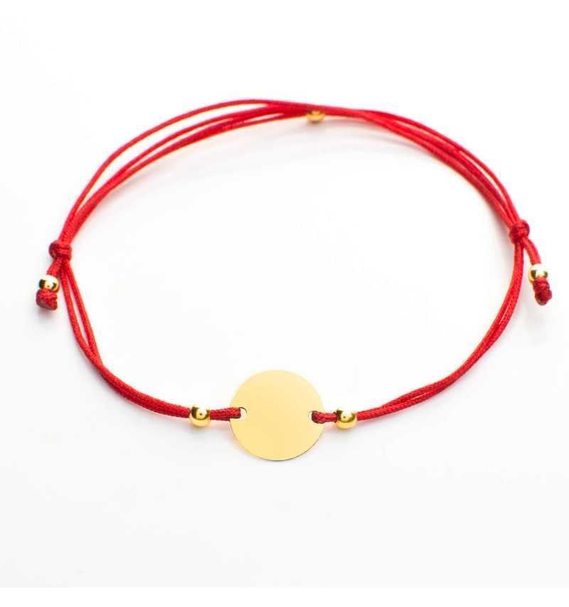 Złota bransoletka z kółkiem na czerwonym sznurku