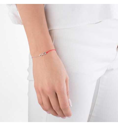 Srebrna bransoletka na czerwonym sznurku z symbolem nieskończoności