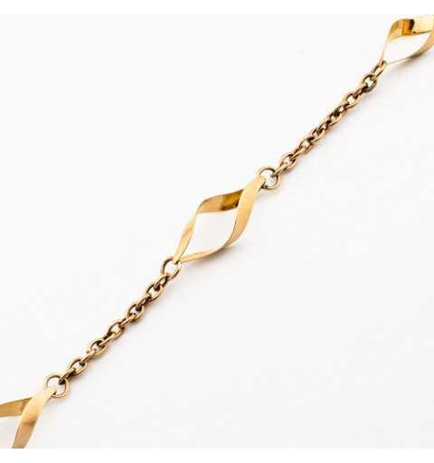 Złota bransoletka z oryginalnymi ozdobami