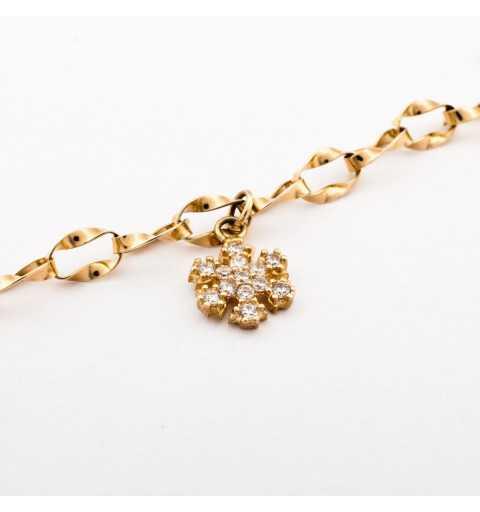 Złota bransoleta z oryginalnymi ozdobami wysadzanymi cyrkoniami