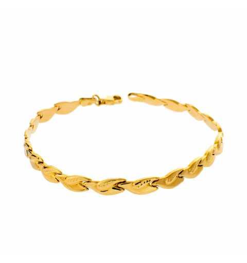 Złota bransoleta elementowa...