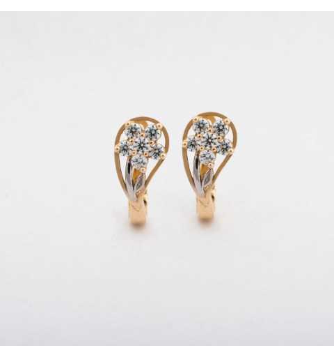 Złote kolczyki z ukrytym kwiatem z cyrkonii